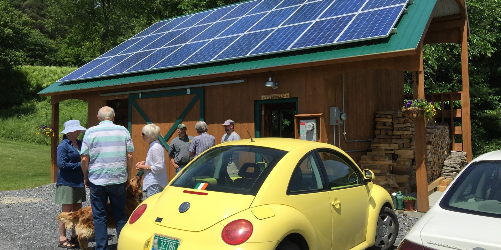 Homeowners, Neil and Theresa Fitzgerald, along with Dan Kinney of Catamount Solar, talking with neighbors about the solar project.