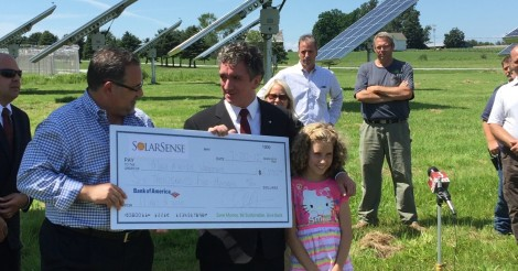 Make-A-Wish Vermont's Jamie Hathaway receives gift from Chris Fraga, CEO of SolarSense